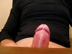 Twink squirts a big load on his black shirt
